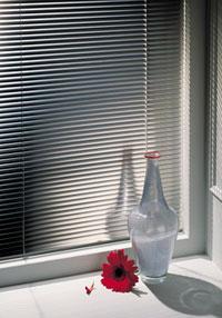 Persienner, mörklägg med en snygg persienn från dittsolskydd.se